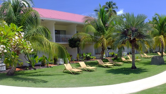 Outdoor Seating At Grand Anse Beachfront Hotel