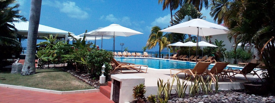 Outdoor pool with sun deck at St. George's hotel