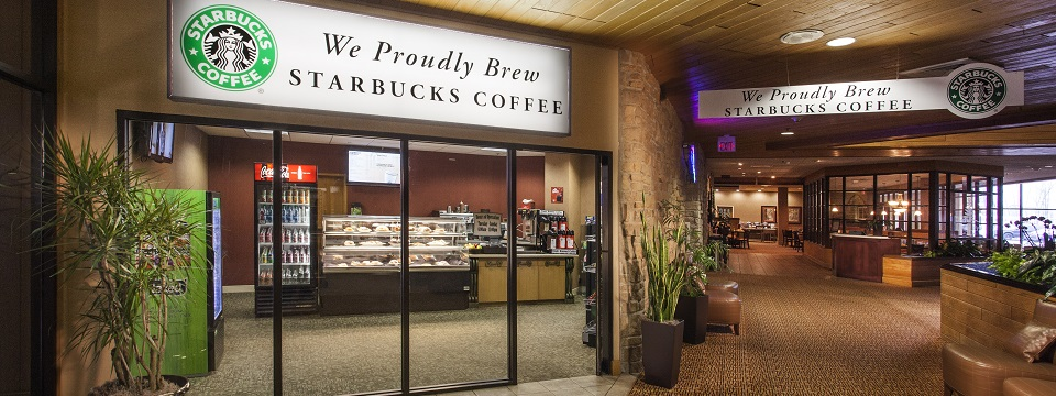 Hotel's on-site Starbucks® coffee shop with a prepared food display