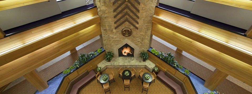 Hotel's spacious lobby bar and fireplace in Green Bay