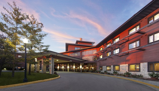 Radisson Hotel & Conference Center Green Bay exterior with a carport