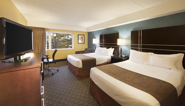 Green Bay hotel room with two queen beds and a flat-screen TV