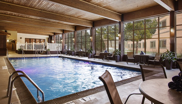 Hotel's indoor pool with plenty of poolside seating