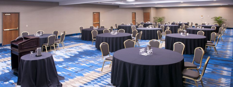 Banquet hall in Green Bay, WI with round tables and glassware