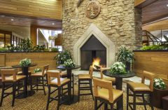Fireplace and table seating in hotel lobby