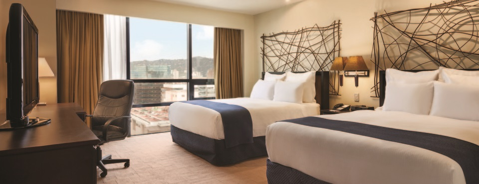 Guatemala hotel's Deluxe Suite with cityscape views