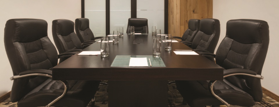 Guatemala meeting room with plush seats and board table