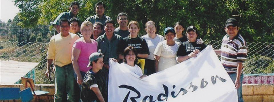 Guatemala hotel staff with a Radisson banner