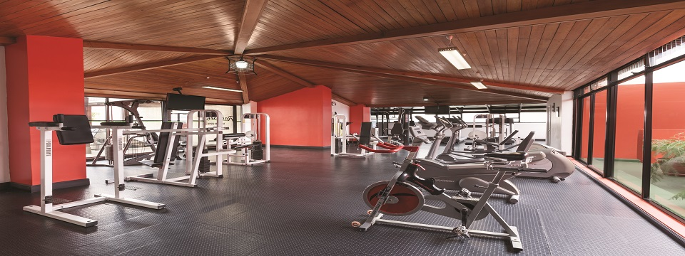 Hotel's fitness center with cardio and weight machines