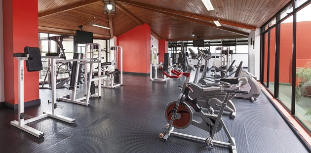 Hotel's fitness center with cardio equipment and weight machines