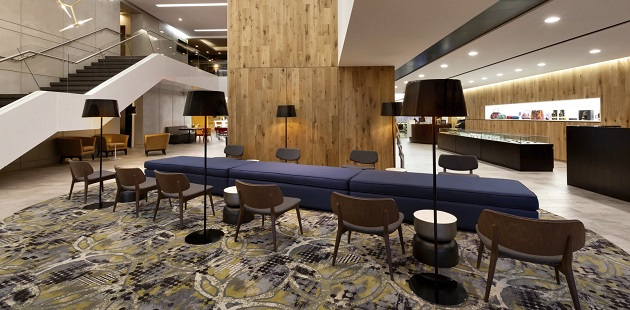 Guatemala City hotel's spacious lobby with a patterned rug and plush seating