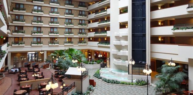 Atrium With Waterfall And Outdoor Dining At Radisson Hotel