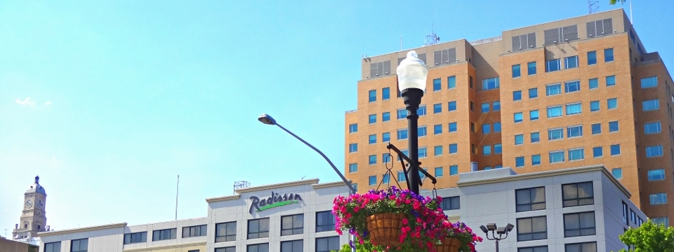 Exterior of Radisson Quad City Plaza with pink flowers