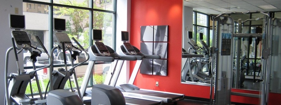 Fitness center with treadmills, ellipticals and weight machine
