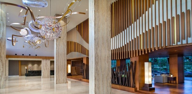 Hotel lobby with stylish decor, modern art and wooden accents