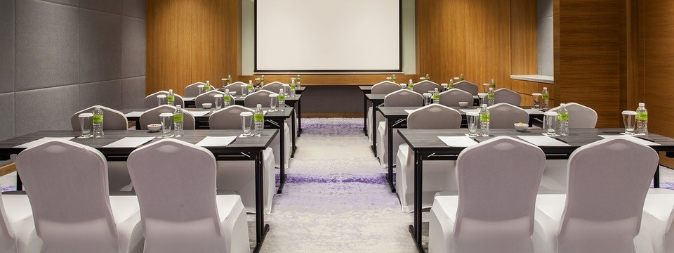 Hotel meeting room and classroom setting with projection screen