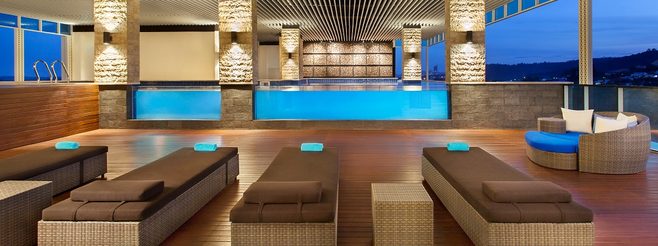Indoor pool with hot tub and seating area
