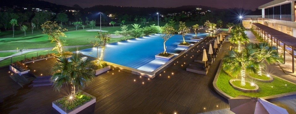Nighttime view of the outdoor pool and patio