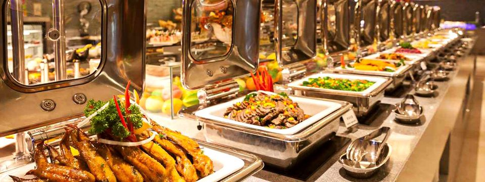 Buffet spread with delicious meats and vegetables