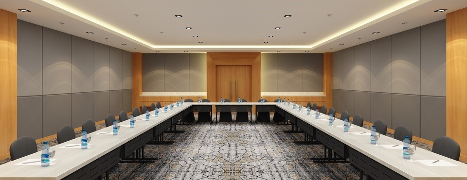 Meeting room set up with stationery and bottled waters