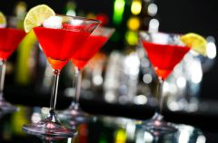 Red cocktails served in martini glasses
