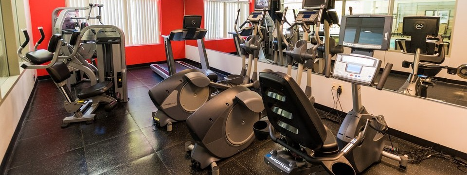 Fitness center with a treadmill and cycling machines
