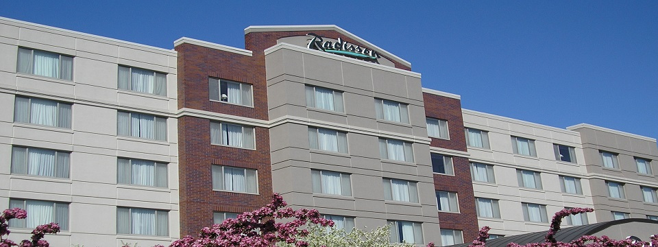 Exterior of the Radisson with pink and white flowers blooming