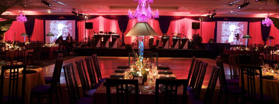 Ballroom with dance floor, tables and colored lighting