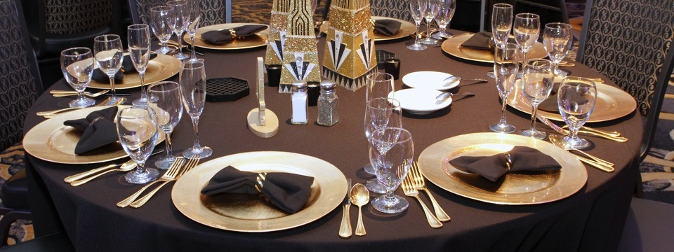 Table settings with carefully arranged plates and glasses