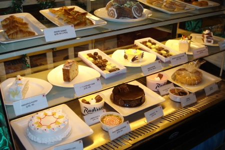 Cakes, pastries and sweets in glass display case
