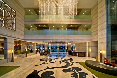 Expansive hotel lobby with extravagant chandelier