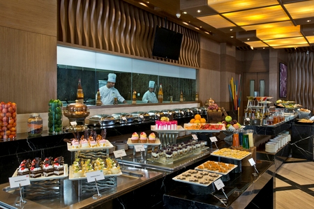 Hotel restaurant with show kitchen and dessert buffet