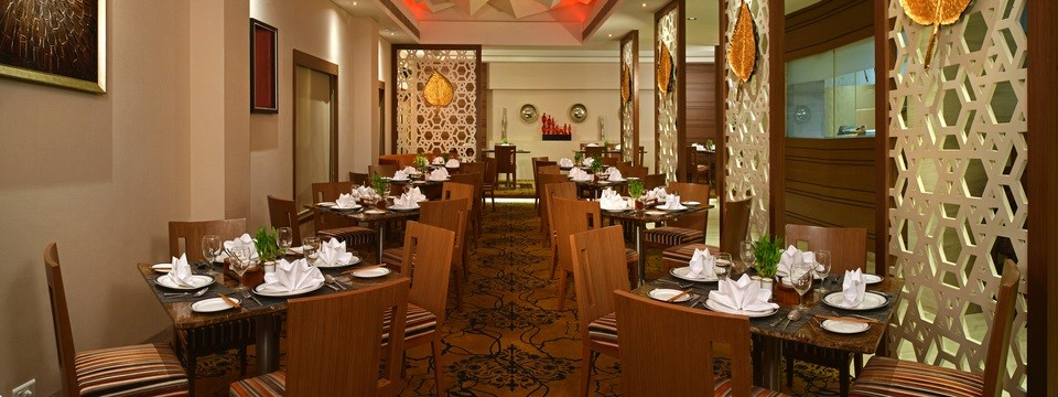 Pan-Asian restaurant with textured geometric ceiling