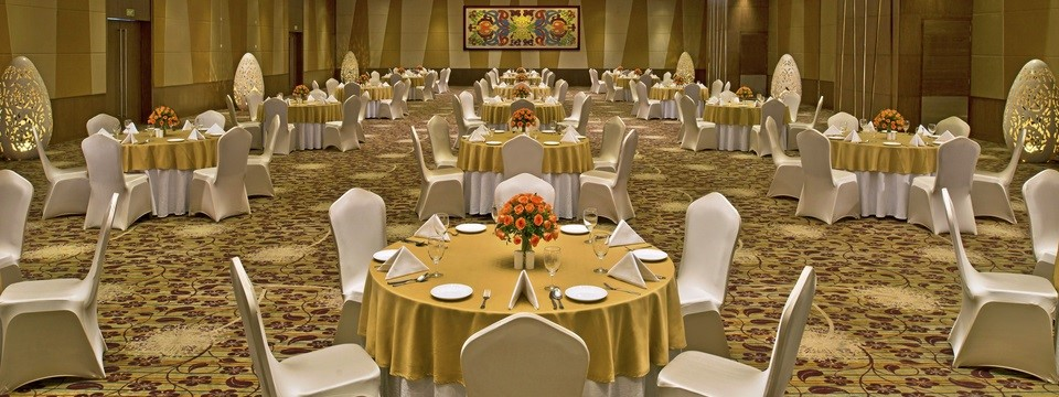 Banquet hall decorated in beige, brown and gold