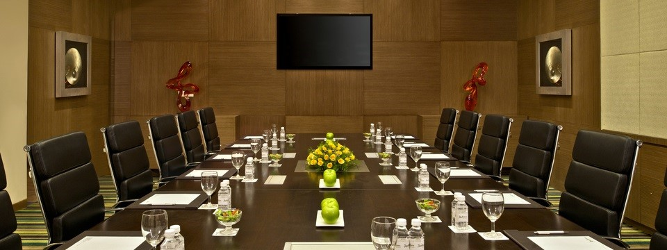 Gandhidham boardroom with flat-screen TV and executive chairs