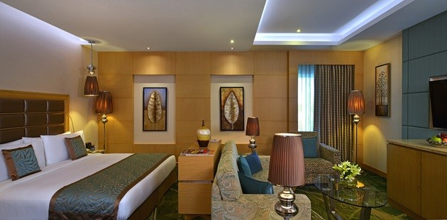 Junior Suite with seating area at foot of the king-size bed