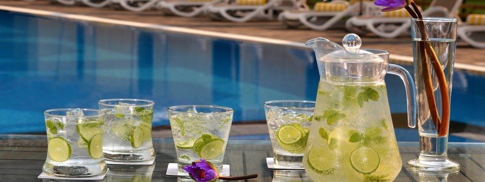 Refreshing drinks on a table next to the pool