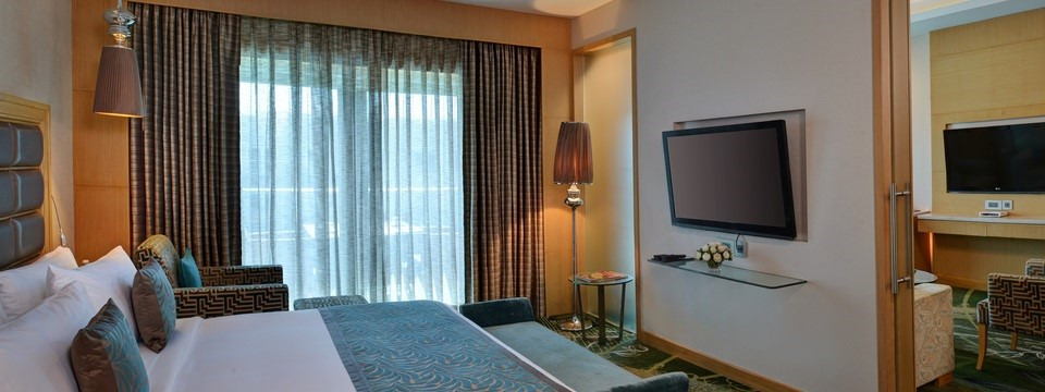 Suite with two flat-screen TVs and private bedroom