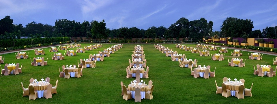 Verdant hotel lawn with banquet-style event setup