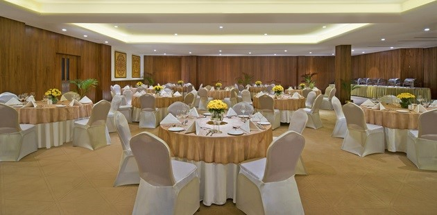Banquet space with round tables surrounded by chairs