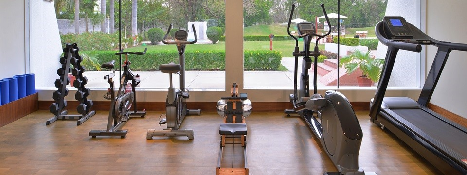 Fitness centre with treadmill, stationary bikes and weights