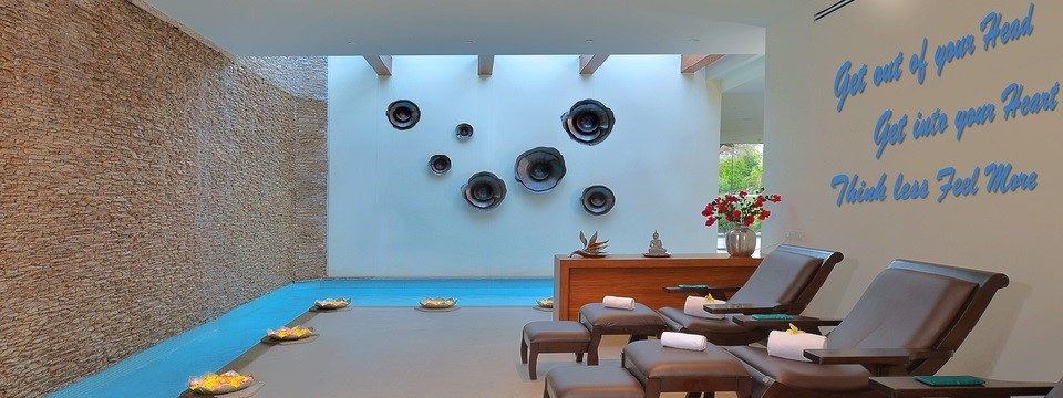 Relaxation area at the spa with lounges and abstract art on the wall
