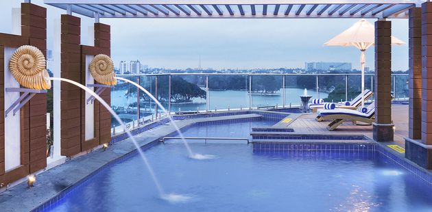 Rooftop swimming pool with water features and stunning views over Ulsoor Lake