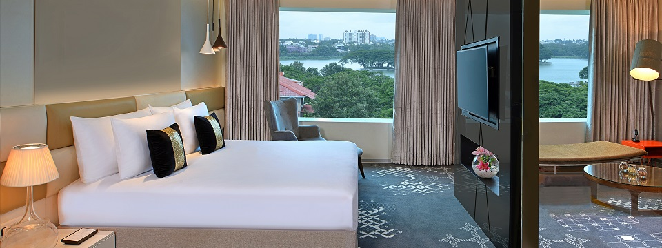 Hotel suite featuring a separate living room and views of Ulsoor Lake and Bengaluru