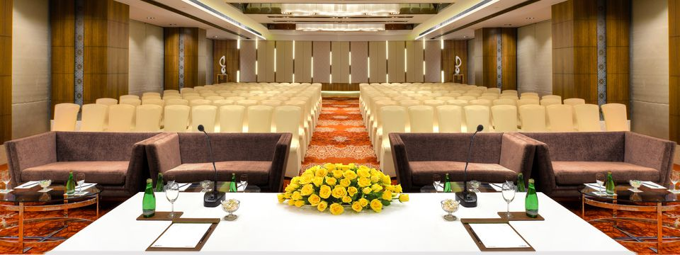 Banquet hall with chairs and sofas in theater style setup