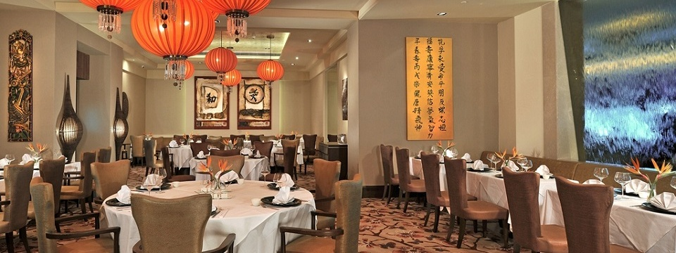 Restaurant with round tables and modern lighting fixtures
