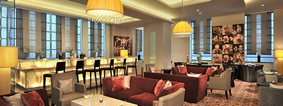 Hyderabad bar with chandelier, bar seating and sofas