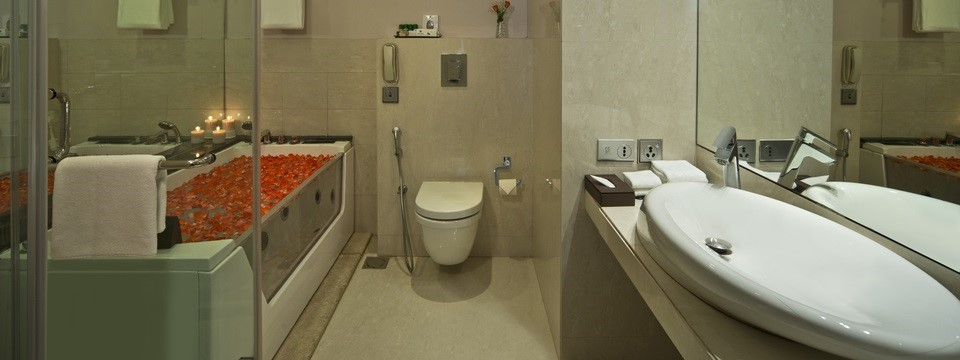 Bathroom with tub filled with flower petals
