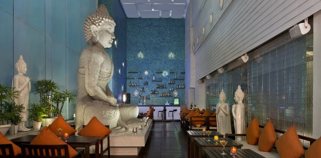 Nirvana bar with large Vedic statue and comfortable seating