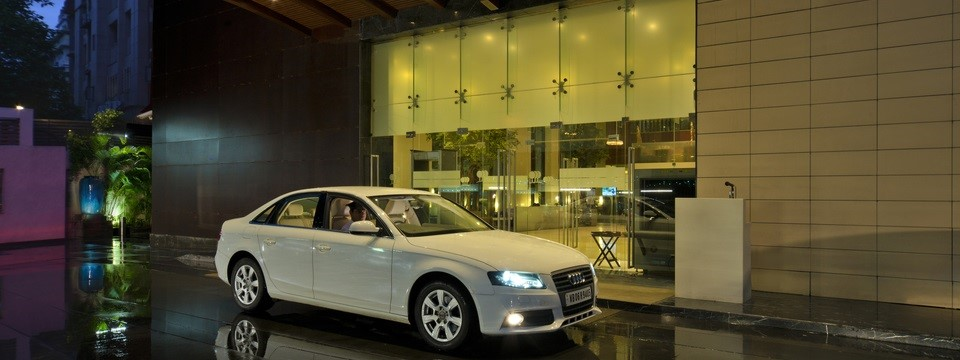 Car parked in front of hotel's front doors for valet service